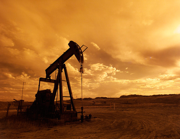 A pump jack silhouetted at sunset near Casper, Wyoming. Photo credit: US DOE.