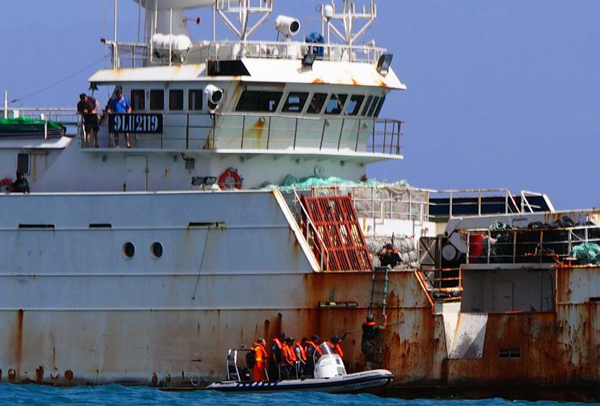 Authorities in Cape Verde board the Songhua, a vessel known to poach toothfish in the Southern Ocean. Photo credit: Sea Shepherd/Josephine Watmore