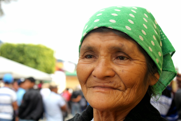 A resident of Mataquescuintla, Guatemala, at a November 2014 celebration of the second anniversary of the municipality's referendum on mining. The referendum was one of many in the region, and residents voted against mining in every one. However, the government was not bound by their decisions. Photo credit: CPR-Urbana / Centro de Medios Independientes