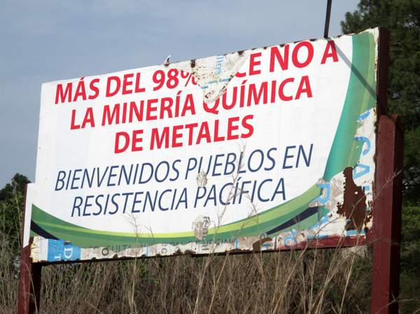Large signs announcing that 98 percent of people oppose metallic mining are placed in communities and municipalities where referendums and consultations have taken place. This sign, situated outside the community of San Juan Bosco, reads 'Welcome To Communities in Peaceful Resistance.' Photo credit: Sandra Cuffe.