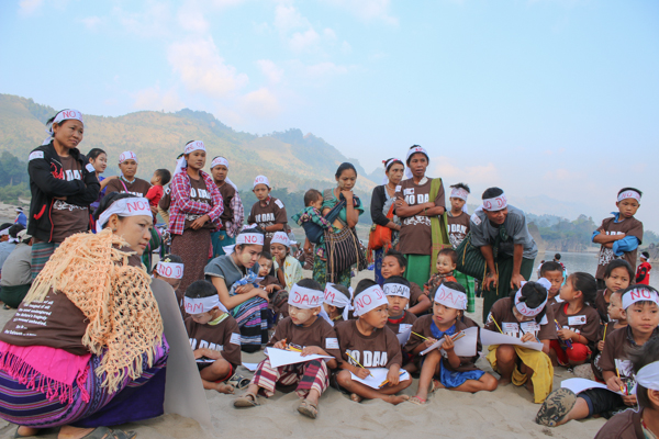 Villagers protest the proposed construction of dams on the Salween River in Myanmar, on International Day of Action for Rivers and Against Dams, March 14, 2015. At least five dams being planned on the Salween have been a flashpoint in altercations between Myanmar government forces and ethnic-minority rebel groups. Credit: Karen Environmental and Social Action Network.
