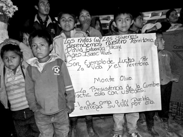 "Children carry a banner commemorating two children allegedly killed in 2013 by an employee of the company that owns the Santa Rita dam. The banner reads in part ""They are examples of the struggle for life and land."" Photo credit: Peoples' Council of Tezulutlán."