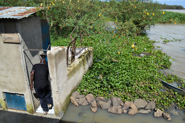 A pit latrine at Dunga Beach in Kisumu, Kenya, empties directly into Lake Victoria. It is one of numerous streams of untreated human waste entering the lake. Photo credit: Isaiah Esipisu.