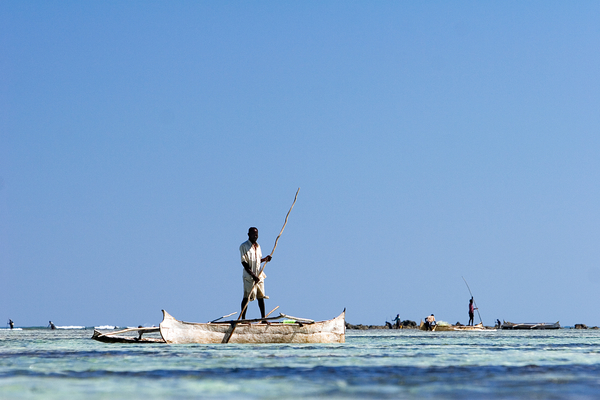 A fisherman punts out to a reef flat to fish for octopus. Photo copyright: Garth Cripps / Blue Ventures 2015.