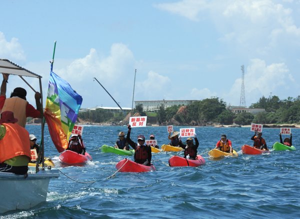 Kayakers rally against the construction of a new US air base in Okinawa in August 2014. Photo credit: Photo credit: ©Greenpeace / Kayo Sawaguchi.