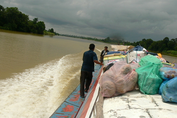 A boat carries cargo up the Baram River, in Sarawak, Malaysia, in August 2011. Photo credit: MyBukit.